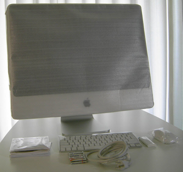 Figure 12. Various items shipped with iMac